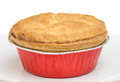 Individual meat pie steak in foil tray Royalty Free Stock Image