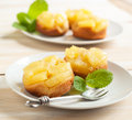 Individual pineapple upside down cakes served on plate Stock Photo