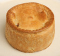 Individual steak pie on plate Stock Images