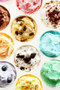 Individual tubs of colorful ice cream on white Royalty Free Stock Photo