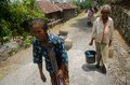 Indonesia climate villagers carry jugs of water in a dry remote area of weru sukoharjo java Stock Photos