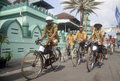 Indonesia demand public welfare bicyle rider of solo java economic growth and development are making the citizens better off and Stock Photos
