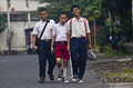 Indonesia education for handicapped blind students are making their way to school in solo java though it is clearly stated in the Royalty Free Stock Photo