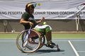 Indonesia handicapped sport a disabled trains how to play tennis in solo java Stock Image