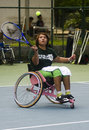Indonesia handicapped sport a disabled trains how to play tennis in solo java Royalty Free Stock Photos