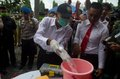 Indonesia narcotics extermination police officers are destroying consficated illegal drugs and alcohols in boyolali data from the Stock Image