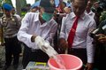 Indonesia narcotics extermination police officers are destroying consficated illegal drugs and alcohols in boyolali data from the Stock Photography