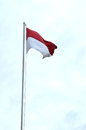 Indonesia s flag against blue sky Stock Photos