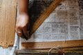 Indonesia to attract new visitors from china volunteers are cleaning ancient wooden scripture the era of th century mataram Royalty Free Stock Image