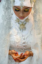 Indonesian bride beautiful dressed in traditional white kebaya Stock Photo