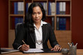Indonesian female lawyer portrait of at her workplace Royalty Free Stock Photo