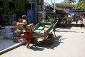 stock image of  Indonesian man loading boxes on to horse and cart in Gili Trawangan