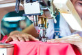 Indonesian seamstress in asian textile factory or worker an sewing with a industrial sewing machine she is very accurate Royalty Free Stock Image
