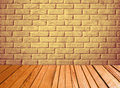 Indoor background with yellow brick wall and wooden plank floor. Royalty Free Stock Photo