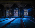 Indoor of ottoman turkish mosque scene showing the rays light passing in to brighten shadowy areas Royalty Free Stock Image