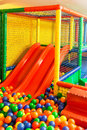 Indoor playground children in arena with slides and colorful balls Stock Photography