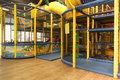 Indoor playground entrance arena for kids with ball guns bumpers punching cylinder slide bridge balls Royalty Free Stock Image