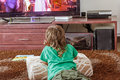 Indoor portrait of young boy watching tv