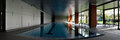 Indoor swimming pool panorama panoramic photo of a private with perfectly still water Royalty Free Stock Photography