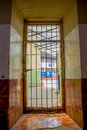 Indoor view with a door with bars, in the old prison Penal Garcia Moreno in the city of Quito Royalty Free Stock Photo