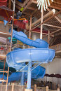 Indoor Waterpark or Water Park Slide Splash Fun Stock Image