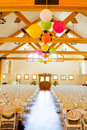 Indoor wedding ceremony venue location for a with rows of white chairs Royalty Free Stock Images