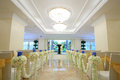 Indoor wedding scene chairs and flowers at a party Royalty Free Stock Image