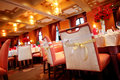 Indoor wedding scene chairs and tables set for dining an party Royalty Free Stock Photos