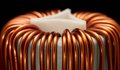 Inductor detail of a electronic conductor in dark back Royalty Free Stock Images