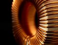 Inductor detail of a electronic conductor in dark back Royalty Free Stock Photography