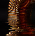 Inductor detail of a electronic conductor on reflective water surface in dark back Royalty Free Stock Image