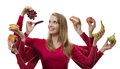 Indulge yourself woman with eight arms holding fruit and cakes in each hand Royalty Free Stock Images