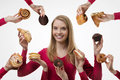 Indulge yourself young woman surrounded by many cakes Stock Photo