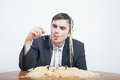 Indulgence and consumerism concept gluttonous businessman eating pasta Royalty Free Stock Image