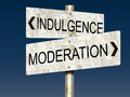 Indulgence vs moderation tin road signs an illustration of or gi galvanized iron Stock Photo