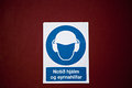 Industial sign icelandic a in that hard hats and ear protection are required Stock Photo