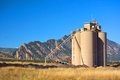 Industrial Agriculture Elevator Silo with Mountains Royalty Free Stock Photo