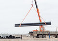 Industrial area unloading by the crane of the production equipm works pipes Stock Photography