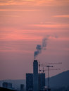 Industrial building with smoke in the sunset Royalty Free Stock Images