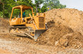 Industrial  bulldozer moving earth  pit or quarry Royalty Free Stock Photo