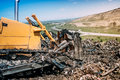 Industrial bulldozer working on garbage dumping site Royalty Free Stock Photo