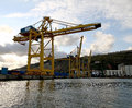 Industrial cargo crane in port Stock Images