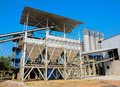 Industrial cement processing facility with blue sky Stock Photography