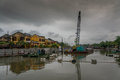 Industrial charm close to the ancient city of hoi an vietnam dramatic sky and reflections in river Royalty Free Stock Images