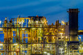 Industrial chemical plant framework profile detail in a heavy with mazework of tubes and pipes during twilight Royalty Free Stock Photos