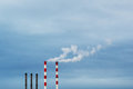 Industrial chimneys against blue cloudy sky industrial background image Royalty Free Stock Photo