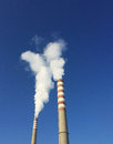 Industrial chimneys with smoke Royalty Free Stock Photo