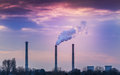 Industrial cityscape with coal power plant and smoke stacks Royalty Free Stock Photo