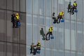 Industrial climbers who wash windows and sanitize glazed surfaces in Romania Royalty Free Stock Photo