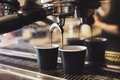 Industrial coffee machine making two cups of espresso Royalty Free Stock Photo